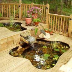 bassin de jardin avec plancher fontaine et belles fleurs