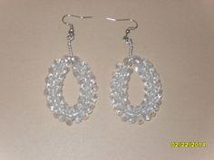 Clear beaded round earrings.