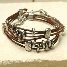 2 Tahoe Bracelets worn together. 1.5 mm cord, pewter beads, sliders, crimps, transitions