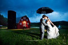barn. umbrella. wedding. rain.