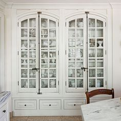 Southern Living, this dreamy china cabinet features antique French windows as doors, plenty of space for china, and a base outfitted with Pacific Silvercloth for storing silver.
