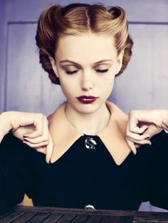 Vintage hair, dark lips, classy as can be.