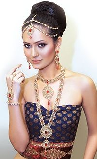 Indian bridal set made from American Diamond stones, 22k gold plated with mild antique & maroon red colour.
