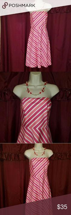 Ann Taylor Strapless Pretty In Pinks Dress ANN TAYLOR Strapless Dress in a mixture of pink colors. Very beautiful and perfect for the up coming season...spring! Size 6 Ann Taylor Dresses Midi