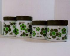 Set of four 1960's Anchor Hocking Avocado Green Mod Daisy Milk Glass Canisters