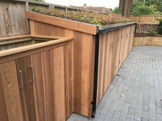 Widest yet! Cedar clad 3x Classics installed as one large. Bin enclosure to left side.