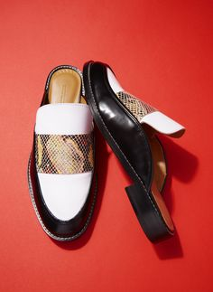 Won Hundred update the loafer for spring summer '17 with a mule-style fit and multicoloured snake-print panel. Slip them on to add a touch of exotic to a loose-fit shirt dress.