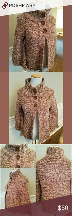 "Free People Rose Gold Metallic Crochet Cardigan The most beautiful rose gold crocheted cardigan from Free People with three large wooden buttons at the neck, rose gold metallic thread woven throughout, 3/4"" bell sleeves and gorgeous detailing. 23"" long, 17.5"" across bust,  8"" wide at bell sleeve, 22"" wide at flared hem. Size small. Perfect condition. Free People Sweaters Cardigans"