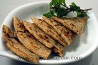 how to make Jammu Ka Aloo Anardana Parantha -Paranthas stuffed with a tangy mixture of potatoes and pomegranate seeds Kashmiri Recipes, Indian Breads, Sanjeev Kapoor, Pomegranate Seeds, Desi, Potatoes, Favorite Recipes, Lunch, Dinner