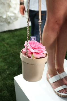 Kate Spade's spring 2015 collection  Surrealism was used as a way to instill humor in fashion during the war. Emphasis was placed on accessories that would come in unexpected shapes, such as the telephone bag in this board. Kate Spade is never one to steer clear of a odd shaped bag, the Spring collection featured surrealist shapes like this flower pot and a watering can that made appearances as handbags.