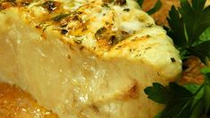 Halibut steaks are 'planked,' barbequed on a water-soaked cedar plank, and basted with a succulent herb and butter sauce.