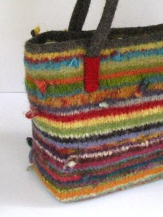 Not unlike a familiar coat of many colors, these felted wool bags were inspired by an overflowing basket of remnant yarn, tied end to end and then circular knitted into ...