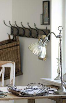 french office decor: worn mirror lamp, locker baskets