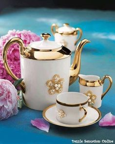 .beautiful tea set with gold trim and porciline