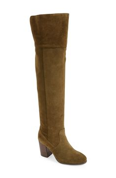 A sleek over-the-knee boot is shaped from lustrous suede and set on a stacked woodgrain heel for a street-chic look you can flaunt day to night.