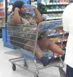 Only In Wal-mart.....I'm curious as to how she got in/out of the cart LOL