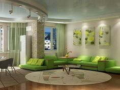 Beautiful room with green sofas.