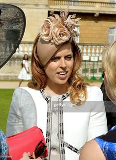 Britain's Princess Beatrice of York attends a garden party at Buckingham Palace, central London on May 28, 2015.  AFP PHOTO / POOL / JOHN STILLWELL        (Photo credit should read JOHN STILLWELL/AFP/Getty Images)