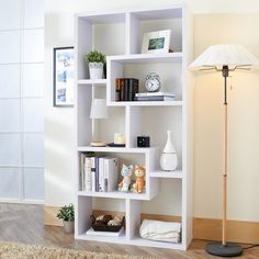 Just add accessories. With the Furniture of America Furniture of America Verena Contoured Leveled Display Cabinet/ Bookcase - White your biggest worry. White Wood Bookcase, Open Bookcase, Contemporary Bookcase, Modern Bookshelf, Contemporary Style, America Furniture, Geometric Shelves, Traditional Cabinets, High Quality Furniture