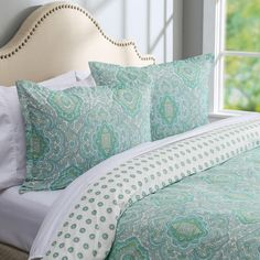 Features:  -Includes long zipper on the side of the duvet cover.  -Material: 100% Cotton.  -150 Thread count.  Product Type: -Duvet set.  Color: -Teal, light blue and green accents.  Pattern: -Damask.