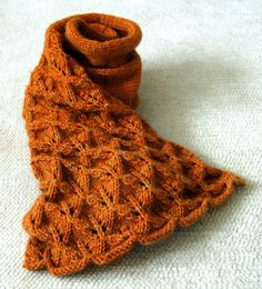 """This Lovely Leaf Lace scarf is made with Lobster Pot's 8-ply cashmere in color """"Chatham Light"""". The stitches that create this beautiful and dimensional pattern are a simple combination of strategic yarn-overs and decreases. The lace pattern has a wonderful dimensionality while the stockinette pattern curls around your neck like a big soft hug."""