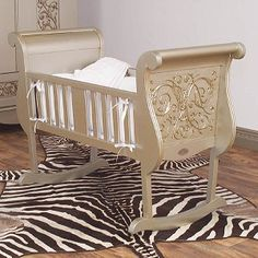 Chelsea Cradle in Antique Silver by Bratt Decor - The cradle in antique silver is an exquisite design. A solid structure, with rocking motion. this beautifully carved cradle is the perfect place for your little one to dream. Bratt Decor has discreetly incorporated an anti-rock, or locking, mechanism that renders the cradle stationary without detracting from the beauty of this product. The manual stopper is fashioned in the same finish as the cradle and sits subtly at its feet. Bedding is not…