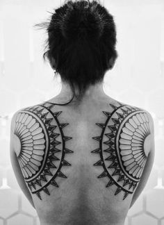 Ink Tattoo: Symmetric Figures Tattoo on Back for Women