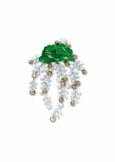 Designed as a carved jadeite peony of bright emerald green color and high translucency, to a cascade of baguette-cut diamond garlands enhanced with rose-cut diamonds and brown diamonds, mounted in 18k white & yellow gold, jadeite peony approximately 15.1 x 26.9 x 3.2 mm, 6.5 cm long