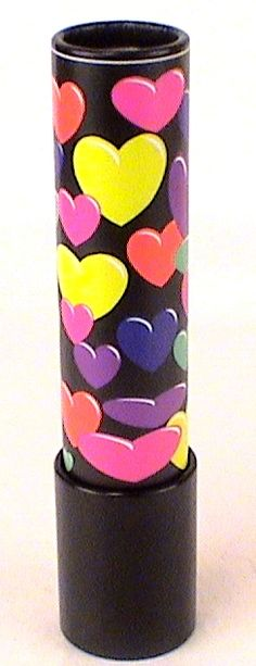 """Unique Valentines Day Gift Ideas, Big Jazzy """"Hearts"""" Theme Kaleidoscope, filled with a variety of brightly colored Beads. Superb mirror and really clear image inside. Also features separate Turning object cell.Stands approx 7 3/8 inches tall and has a diameter of 1 5/8 inches at the separate moving chamber. Great Optics Inside. Highly Recommended.Customer Reviews Sandra ordered a Big jazzy Fish Pattern kaleidoscope and a classic tin and wrote back """"""""Excellent service.  I ordered 2…"""
