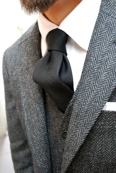 Matching tweed jacket and waistcoat with crisp white shirt and white pocket square (handkerchief)