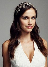 This stunning show stopping crystal floral headpiece will catch everyone's eye!  Opulent headpiece features gorgeous crystal floral accents.  Elastic back adds comfort and support.  Available in Gold and Rhodium.  Imported.