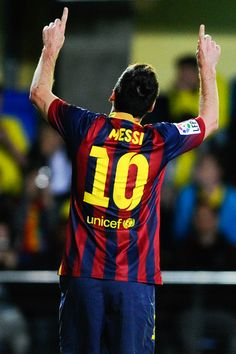 Lionel Messi of FC Barcelona celebrates after scoring his team's third goal during the La Liga match between Villarreal CF and FC Barcelona at El Madrigal on April 27, 2014 in Villarreal, Spain.