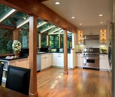 Interior design Nature Glass Roof, House Designs Featuring Glass Extensions Enjoy Nature From The Comfort Of Your Home Interior Conservatory Kitchen, Sunroom Kitchen, Greenhouse Kitchen, Kitchen Windows, Window Greenhouse, Kitchen With Sunroom Attached, Kitchen Extension Glass Roof, Modern Conservatory, Greenhouse Ideas