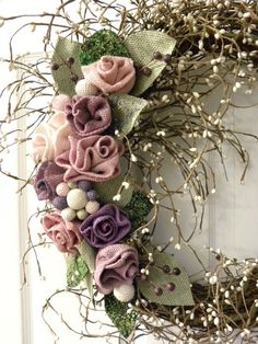 Unique 16in grapevine wreath with white berries and pastel burlap roses. Hang this unique shabby chic accent in any room/door to enhance your design. It would also make for a special gift.