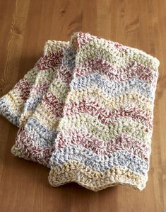 Two strands of yarn held together give this quick and easy scarf a tweedy look. (Lion Brand Yarn)