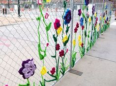 Flowers yarn bombing fence. Lovely idea for the playground.