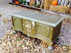Antique trunk painted with Annie Sloan Chalk Paint in Olive, Duck Egg Blue and Versailles and sealed with dark wax.