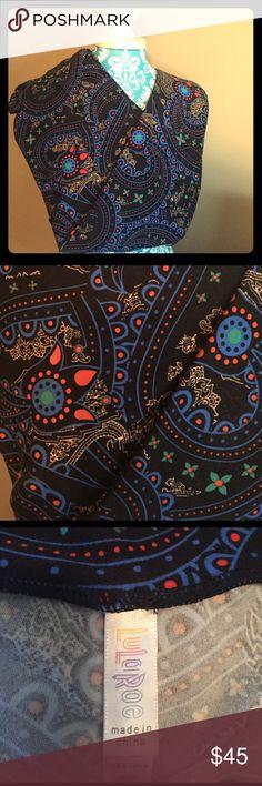 LuLaRoe TC Black Paisley Leggings LuLaRoe TC Leggings Worn once & washed per LLR standard. Simply cannot wear TC anymore. Black background with royal blue, orange. green and peach colors in a Paisley design. SUPER Fun print!!!  LuLaRoe Pants Leggings