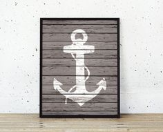 A rustic faux-wood nautical anchor print. Choose your design from the 9 shown on the second photo. Images include: Anchor, Crab, Oars, Sailboat,