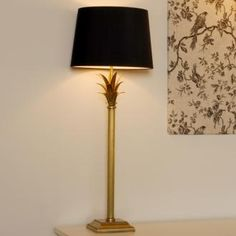 The regency table lamp is a handmade brass table lamp that works brilliantly with an array of lampshades. We have paired it with a simple black shade here to highlight the golden tones of the brass. www.jim-lawrence.co.uk