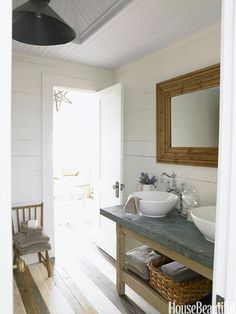 "Rustic Bathroom ""This bathroom console in the guesthouse was an antiques fair find,"" says designer Ginger Barber. ""It all about the back and forth, crisp white vessel sinks and white walls against the worn zinc top and rustic baskets. Modern Vintage Bathroom, Rustic Bathroom Designs, Best Bathroom Designs, Simple Bathroom, Bathroom Ideas, Design Bathroom, Bathroom Colors, Bathroom Interior, Cozy Bathroom"