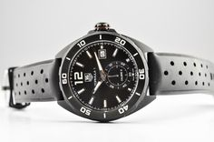 Pre-owned Tag Heuer 41mm Formula 1 automatic black dial and black rubber men's watch. Stianless steel case coated in black titanium and graced with black rubber strap, luminescent hands & markers, a date display at the 3 o'clock position and a small second sub-dial at the 6.