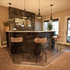 Basement Design - rock bar.  Notice the carpet and tile tie in!