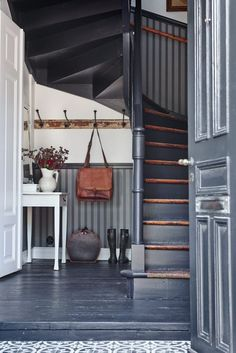All gray-blue painted floors, walls and doors