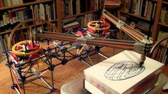 This is a fully functional K'nex Harmonograph (or more specifically a Pintograph, since it uses rotating disks and not pendulums). Two sets of gearboxes, the. Drawing Machine, Amazing Gifs, Kinetic Art, Cardboard Art, Circuit Design, Learn Art, Drawing Techniques, Op Art, Art Lessons