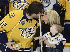 So sweet <3 Carrie Underwood, Mike Fisher and baby Isaiah Celebrating Mike's 1000 game! @blownxawayx94