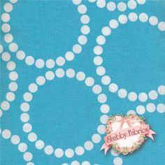 """Pearl Bracelets 4116-B1 By Lizzy House For Andover Fabrics: Pearl Bracelets is a collection by Lizzy House for Andover Fabrics.  100% cotton.  43/44"""" wide.  This fabric features white dotted circles on a blue background."""