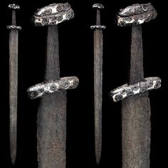 "myArmoury.com A Northern European Viking Sword, 11th century Broad double-edged blade with a flat fuller on each side. The upper quarter of the blade with plain straight-armed cross inlaid in bronze on both sides. Short, slightly curved cross-guard, tapered tang with pommel made in two pieces. Hilt entirely covered with silver and decorated with concentric circles. Overall length: 92.5 cm (36.42"")"