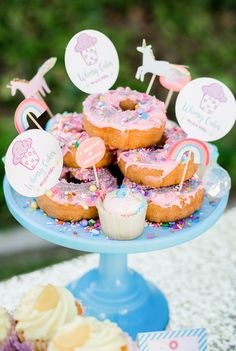 Create a magical donut with unicorn cupcake picks! Donut Birthday Parties, Trains Birthday Party, Donut Party, Birthday Ideas, Unicorn Cupcakes, Unicorn Party, Mermaid Cupcakes, Rainbow Unicorn, Mini Donuts