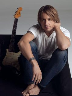 Keith Urban- I don't kow what is more sexy, his hair, his accent or the way he plays that guitar!